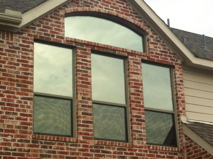 Vinyl Replacement Windows in North Dallas, TX on a brick house