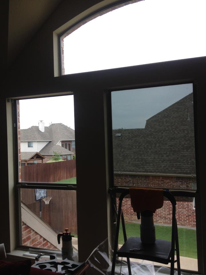 Applying window film on a Plano, TX, window